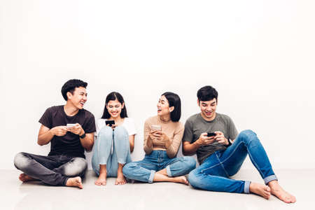 Photo for Group of friend sitting relax use technology together of smartphone checking social apps against copy space background.Communication concept - Royalty Free Image