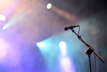 Photo for Microphone with spotlights with colored lights at a rock concert. - Royalty Free Image