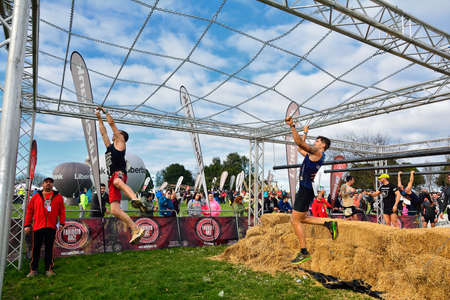Photo pour Gijon, Spain - January 21: Farinato Race, extreme obstacle race in January 21, 2018 in Gijon, Spain. People jumping, crawling,passing under a barbed wires or climbing obstacles during extreme obstacle race. - image libre de droit