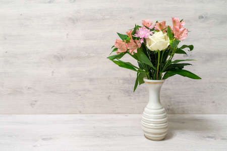 Photo for Colorful spring bouquet of rose, chrysanthemum and alstroemeria flowers in a vase - Royalty Free Image