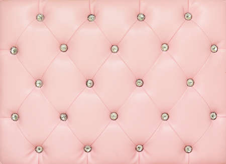 Vintage pink leather background with crystal button