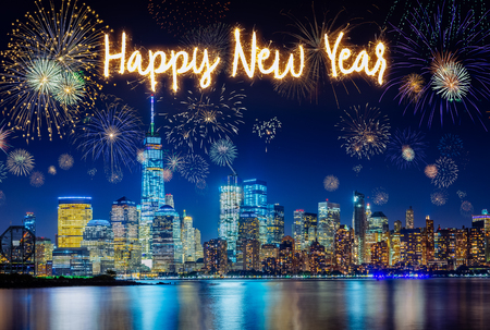 Photo for New York City Skyline with Flashing Fireworks celebration of new years eve with happy new year handwriting - Royalty Free Image