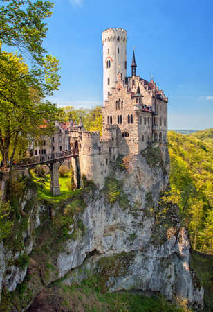 Foto de Romantic Lichtenstein castle with fancy decorated towers sitting on a rock in Black Forest, Wurttemberg, Germany - Imagen libre de derechos