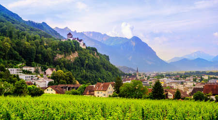 Photo for Vaduz town, panoramic view of the capital of Liechtenstein with the Castle Vaduz, Alps mountains, Europe - Royalty Free Image