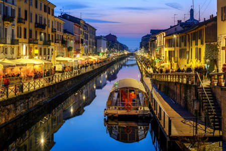 Photo pour Milan city, Italy, Naviglo Grande canal is a popular illuminated in the late evening - image libre de droit