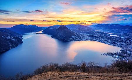 Foto de Dramatic sunset over Lake Lugano in swiss Alps, Ticino, Switzerland - Imagen libre de derechos