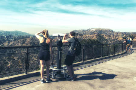Photo for Los Angeles, CA, USA - February 02, 2018: Tourists visiting Griffith park observatory looking at Hollywood Sign in the distance. - Royalty Free Image