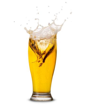 Foto de Beer splash in glass isolated on white Clipping Path - Imagen libre de derechos