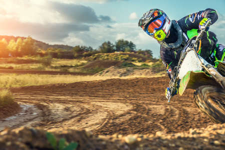 Photo pour Extreme Motocross MX Rider riding on dirt track on a sunny late summer day on public training session in preparation for Motocross event - image libre de droit
