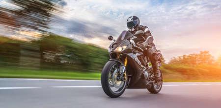 Foto de motorbike on the road riding. having fun driving the empty road on a motorcycle tour journey. copyspace for your individual text. - Imagen libre de derechos