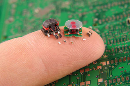 Photo for Small electronics components on human finger - Royalty Free Image