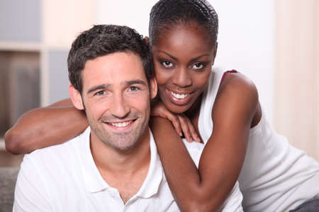 Landscape portrait of a mixed race couple indoors