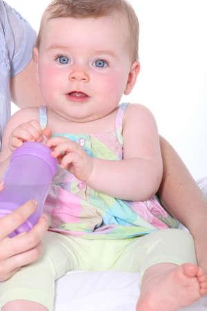 holding infant