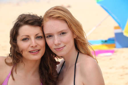 Two young women on a sandy beach