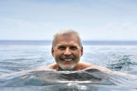 Elderly man swimming