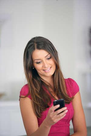 Woman sending a text message