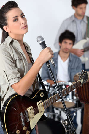 Female singer in a band
