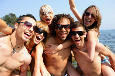 Photo for Group of young adults partying at the beach - Royalty Free Image