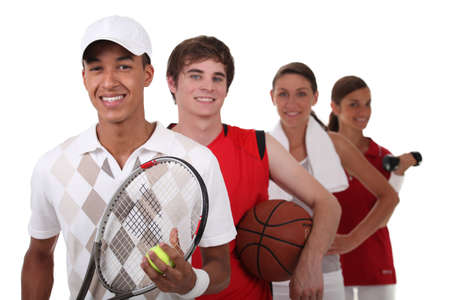 Four teenagers dressed for different sports