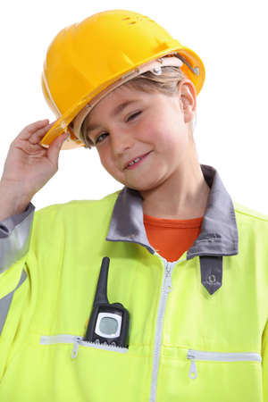 small girl disguised as a site foreman