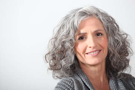 Foto de Grey-haired woman on white background - Imagen libre de derechos
