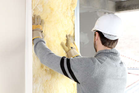Photo for craftsman insulating a wall - Royalty Free Image