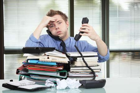 Photo pour Office worker overworked - image libre de droit