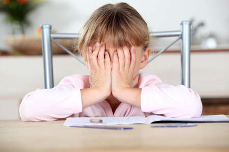 Frustrated child unable to complete her homework