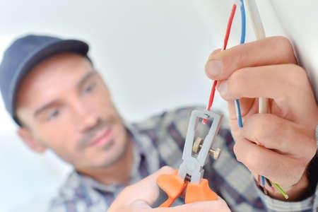 Foto de Electrician snipping a wire - Imagen libre de derechos