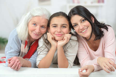Photo pour Three generation of women on a sofa - image libre de droit