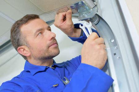 Photo pour Installing a new garage door - image libre de droit