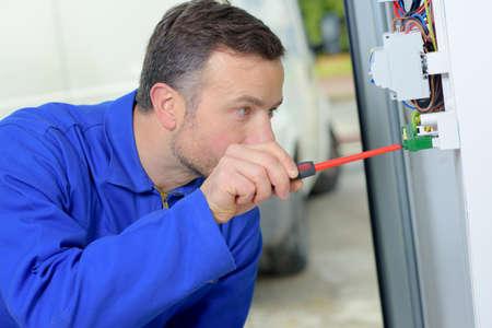 Foto de Electrician working on a fusebox - Imagen libre de derechos