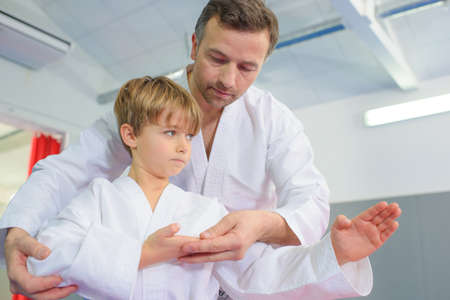 Little boy in a karate lesson