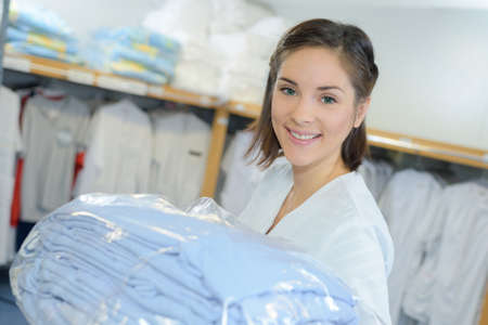 Photo pour portrait of worker putting away laundry in hospital - image libre de droit