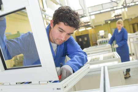 Photo pour People working in window factory - image libre de droit