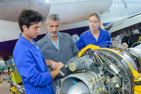 Photo for Students working on aircraft component - Royalty Free Image