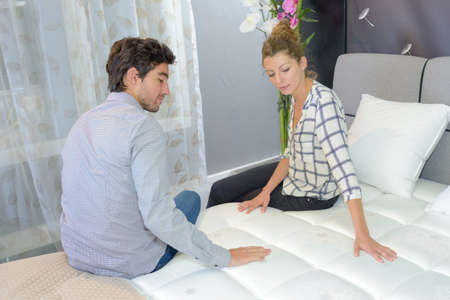 Photo pour accommodation inspector testing the bed - image libre de droit