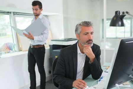 Photo pour Men at work in office - image libre de droit