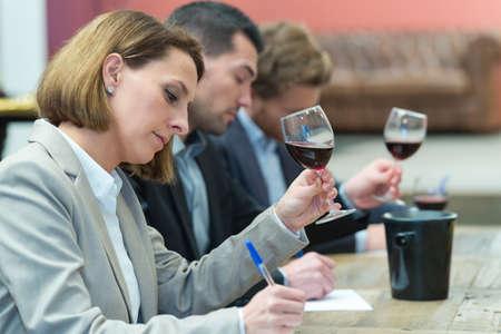 Photo pour critics grading the wines for the awarding - image libre de droit
