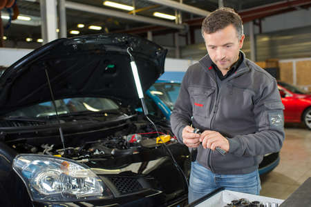 Photo pour car mechanic working with tool in service workshop - image libre de droit