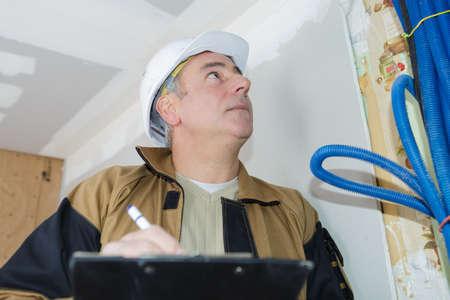 Photo pour builder inspection checking the electrics - image libre de droit