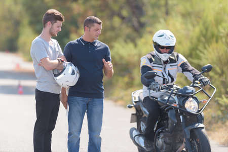 Photo for driver instructor controls motorbike pilot - Royalty Free Image