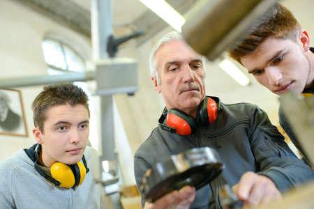 Photo pour group of students in woodwork training course - image libre de droit