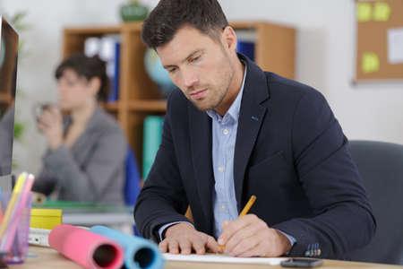 Photo pour male worker drawing the concept - image libre de droit