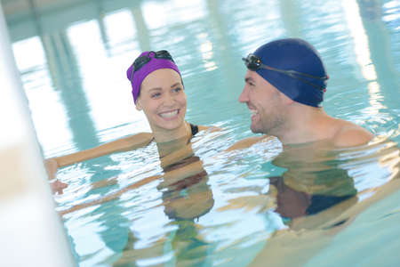 Photo pour couple of swimmers swimming in an indoor swimming pool - image libre de droit