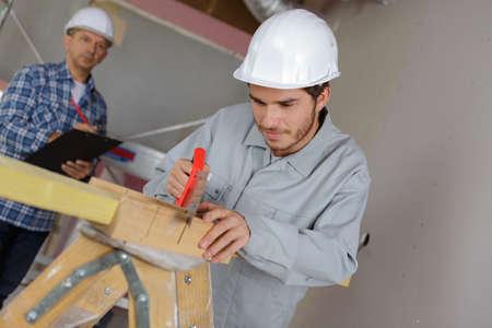 Photo pour Apprentice being evaluated - image libre de droit