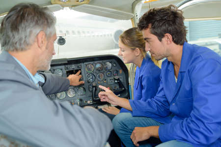 Photo pour Students in aircraft cockpit - image libre de droit