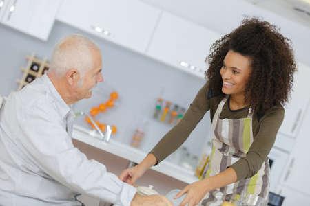 Photo pour health care worker serving a meal to an elderly patient - image libre de droit