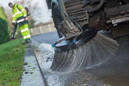 Photo pour close up of a truck cleaning a street - image libre de droit