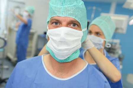 Photo pour portrait of a surgeon in front of the operation room - image libre de droit